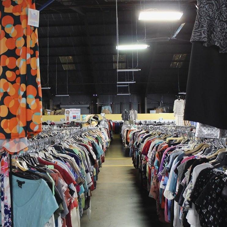 Aisle of donated clothes for sale at a Vinnies thrift store