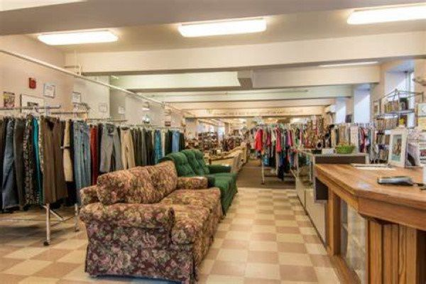 Clothes and furniture for sale in a New Hampshire thrift shop
