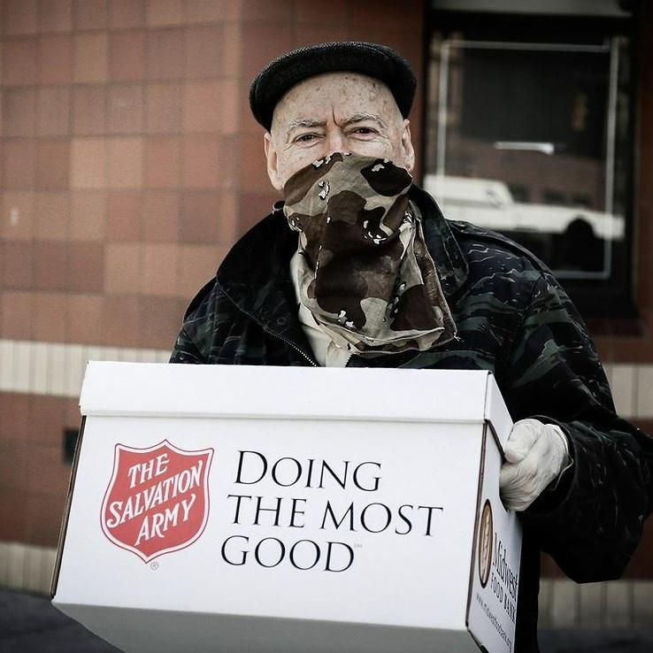 Eldely man donating goods at a Salvation Army drop point