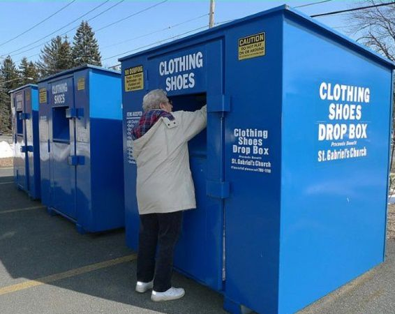 Elderly woman donating clothes to a Tennessee donation bin