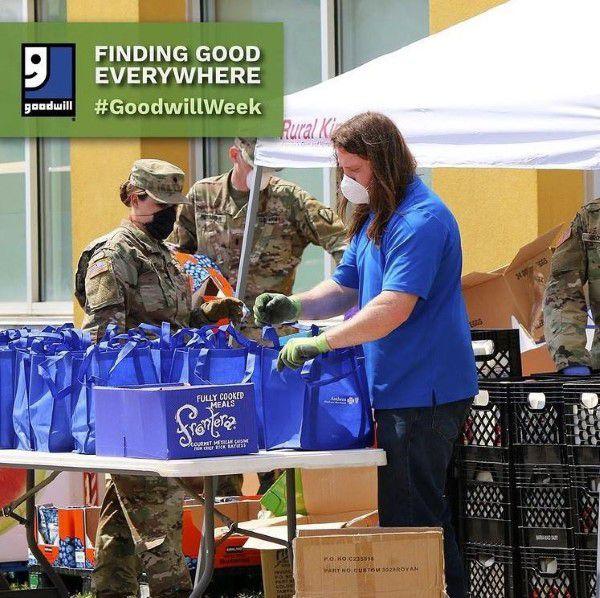 Man volunteering at Goodwill donation center
